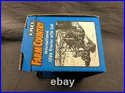 1976 Ertl 116 scale Farm Country International 1586 Tractor withcab Blue Box