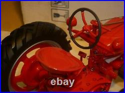 A Franklin mint of a scale model of a International farmall model H, tractor