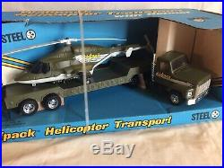 Ertl Toys 1987 Wolfpack Helicopter & Transport Truck withHelmet In Box