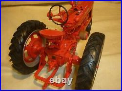 Franklin mint of a scale model of a 1941 McCormick Farmall tractor. 1/12 scale