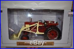 NEW 1/16 International Harvester 504 tractor with loader & chains, very nice