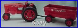 Vintage 1950 International Farmall plastic toy tractor with plastic wagon